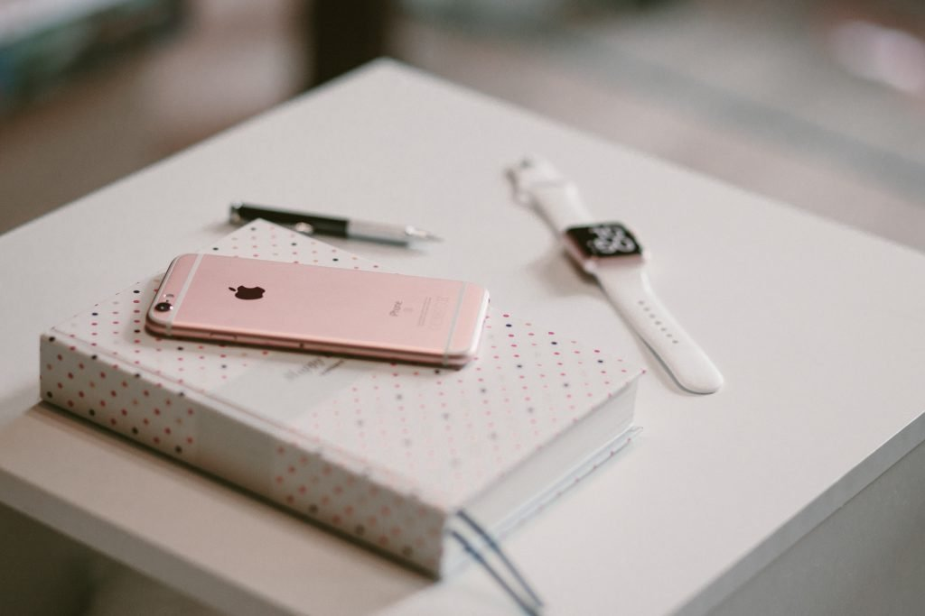 rose-gold-iphone-6-s-on-top-of-white-covered-book